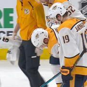Weber carried off the ice after knee on knee from Bruins' Kuraly.