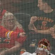 Beautiful woman tears up after young Flames fan gives her his puck!