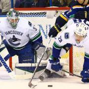 Canucks cut mammoth defenseman, two others clear waivers