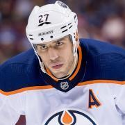Milan Lucic flattens Flames captain Mark Giordano with a huge hit.