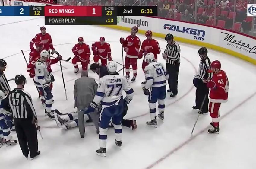 Girardi takes a one-timer slap shot to the head!