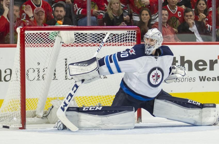 Jets name their starter amidst tense goaltending battle in Winnipeg.