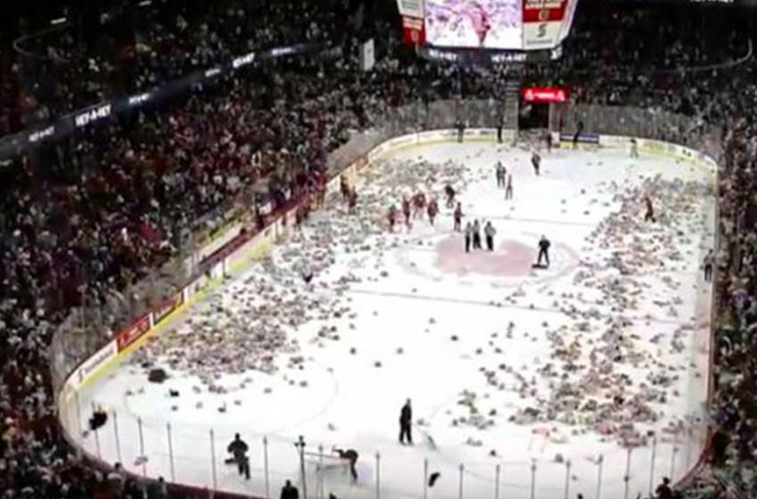 Watch 24,605 teddy bears hit the ice in Calgary!