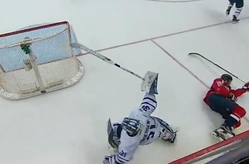 Leafs goalie Frederik Andersen delivers a big hit behind his net!