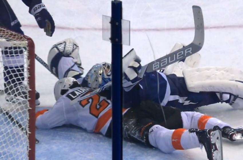 Breaking: Veteran goalie goes down after getting hit from behind.