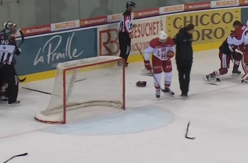 Former NHL goalie and former NHL forward drop the gloves.