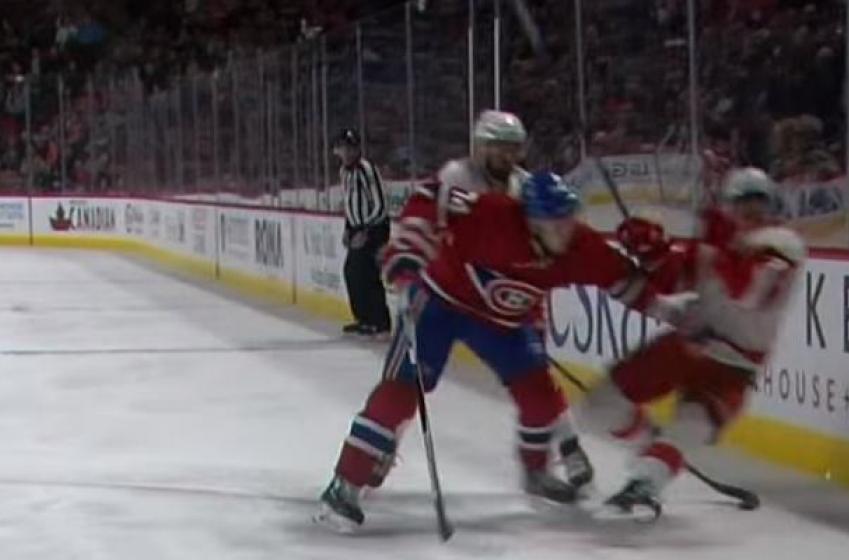 Red Wings star rookie Larkin shaken up on huge hit from Emelin.