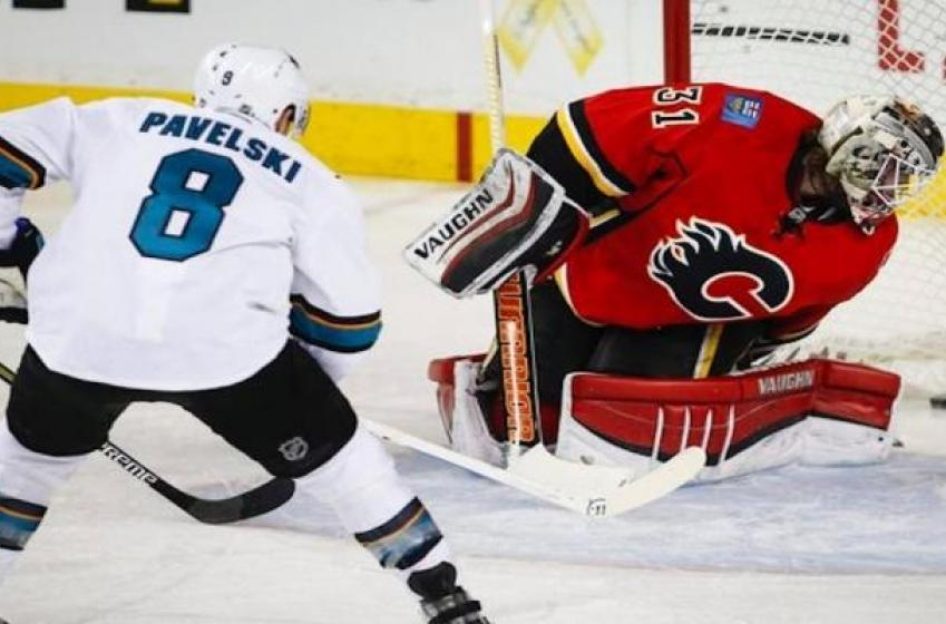 Flames lose high scoring affair against Sharks.