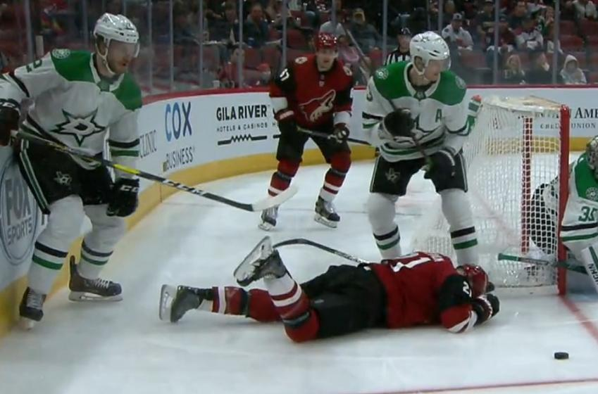 Jamie Oleksiak destroys Derek Stepan with a massive hit behind the net.