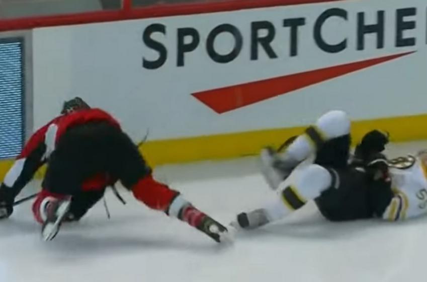 Throwback: Chris Neal hits Johnny Boychuk so hard both men go down.
